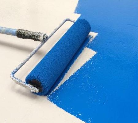 applying epoxy flooring in warehouse