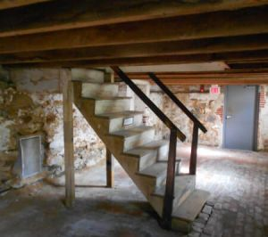 Staircase leading to empty basement