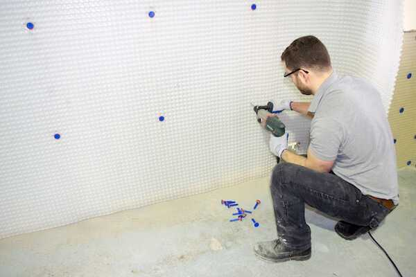 Drilling brick plugs into basement membrane