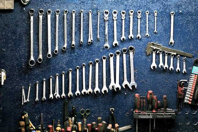 tools arranged on the wall of a man cave