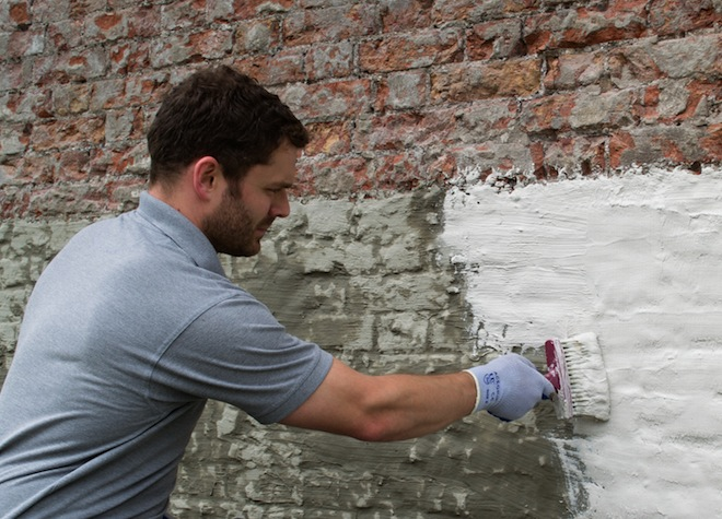 applying tanking slurry in basement
