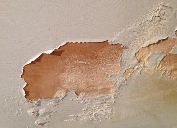 Plaster damage on interior wall